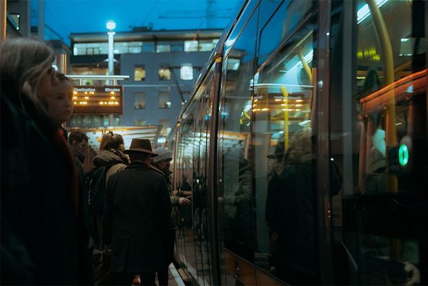 Crowds waiting to board a tram in Dublin.