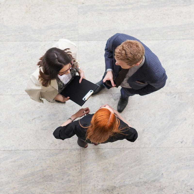 Bird's eye view camera shot of three adults talking