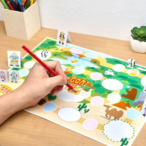 A colourful, customisable printed board game, with papercrafted characters on a tabletop.