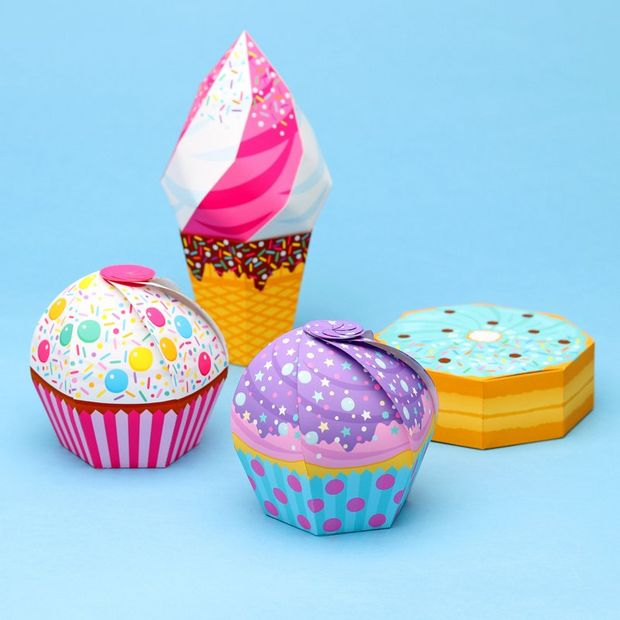 Papercraft boxes folded to resemble sweet treats.