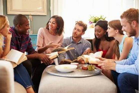 Group of friends taking part in book club