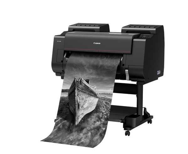 A Canon imagePROGRAF PRO-2000 printer outputting an image of a boat.