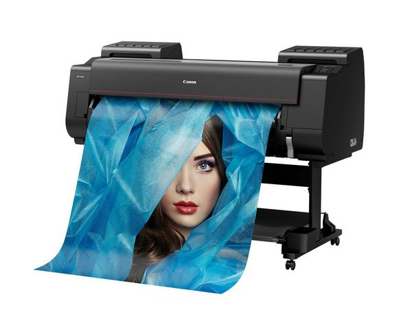 A Canon imagePROGRAF PRO-4000 printer outputting a poster-size image of a woman's face shrouded in blue.