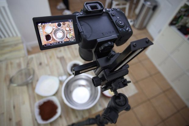 A Canon EOS 90D on a tripod filming ingredients laid out on a table.