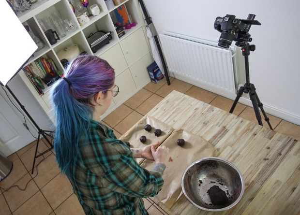 A Canon EF 100mm f/2.8 Macro USM lens. A woman with multi-coloured hair making cookies.