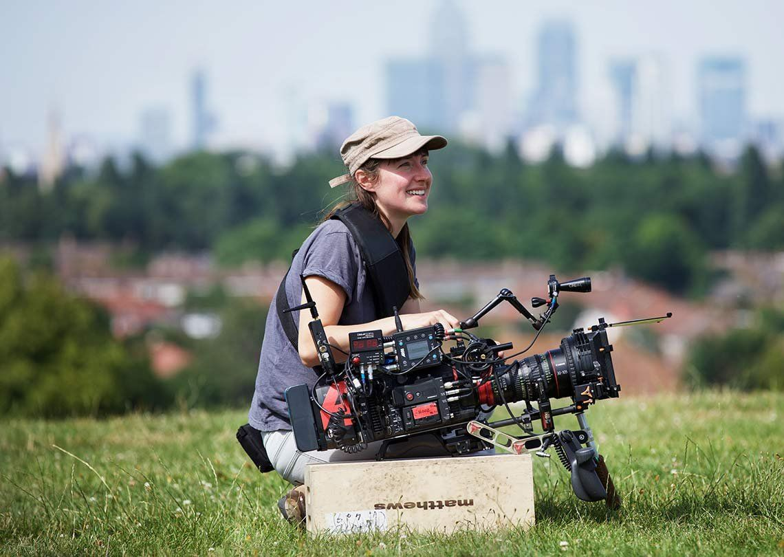 Female cinematographer Laura Bellingham on the set of Stump, with the EOS C700 in front of her.
