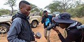 Neville Ngomane hold a piece of rhino horn after watching a dehorning