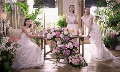 Fashion Shot - Group shot, three women in white dresses one sitting and two standing, surrounded by plants and flowers - taken with a EOS 5D Mark IV