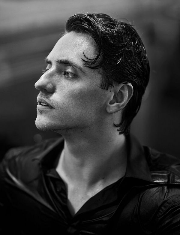 Sergei Polunin, formerly the Royal Ballet's youngest ever principal dancer, is captured in side profile, in black and white, gazing out of frame.