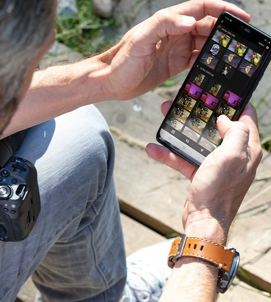 Person holding camera and using mobile app