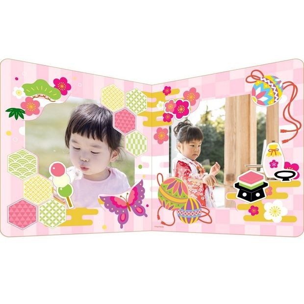 A pale pink papercraft photo frame.