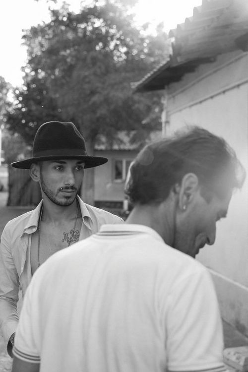 Life in low light - Two men talking one with hat - taken with a EOS 5D Mark IV