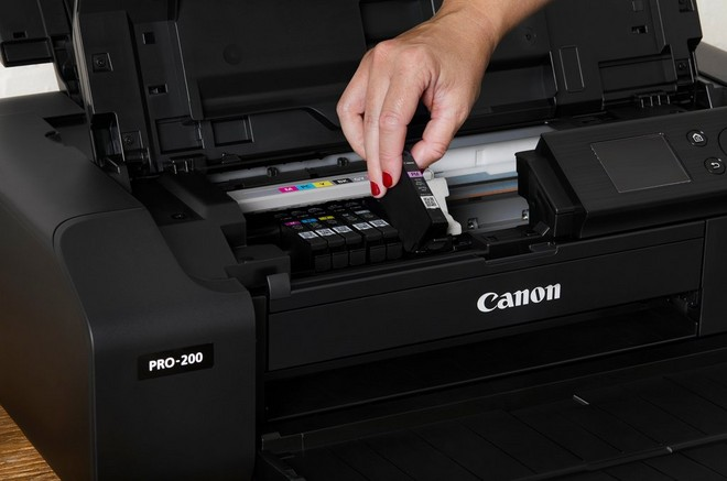 The ink being changed in a Canon PIXMA PRO-200 printer.