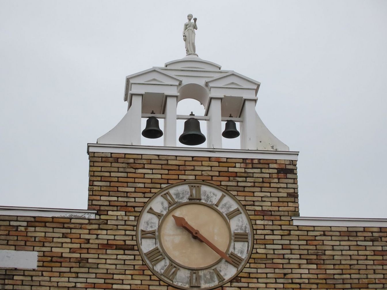 Canon PowerShot ZOOM sample image of a town hall clock tower shot at 100mm focal length