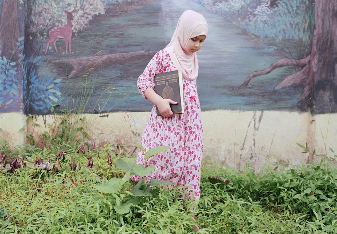 A young female student wearing a hijab walks through the grounds of the Qur'an school in Rize, Turkey.