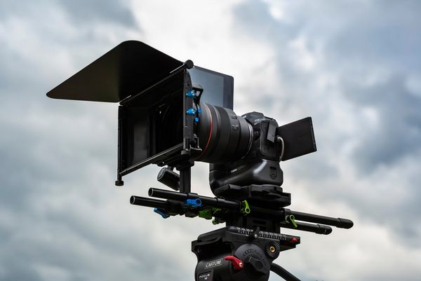 A Canon EOS R5 camera mounted on a tripod.