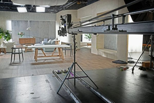 A grey and white furniture set with a Technocrane set up to film over the top.