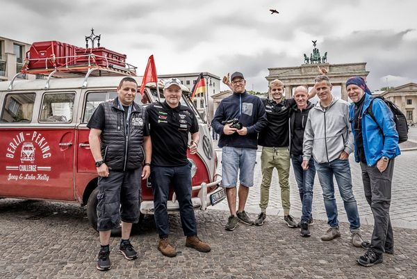 Joey Kelly, Clemens Boecker and the rest of the team near the Brandenburg Gate in Berlin with their VW campervan.