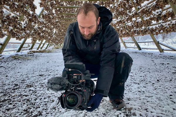 Roberto Palozzi films low to the snowy ground inside a huge wooden frame covered in air-drying fish.