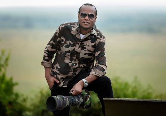Photographer and Canon Ambassador Clement Kiragu with a Canon camera and long lens.