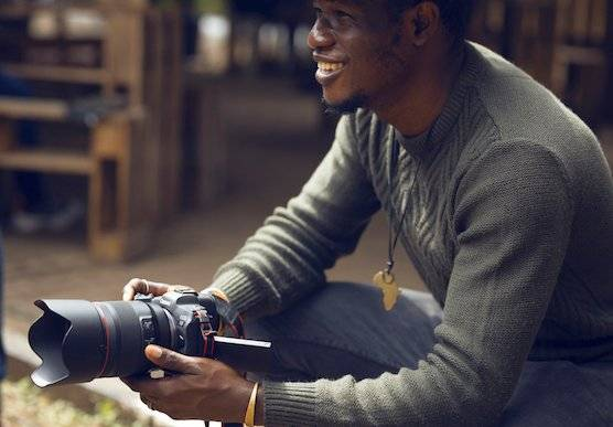 Photographer and Canon Ambassador Emmanuel Oyeleke with his Canon camera.
