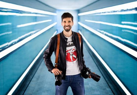 Photographer and Canon Ambassador Fabio Mirulla with two Canon cameras.