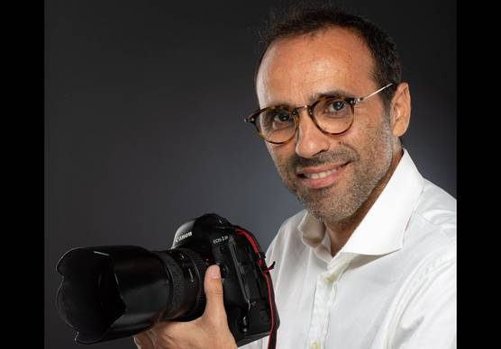Photographer and Canon Ambassador Karim Tibari with his Canon camera.