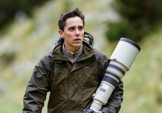 Photographer and Canon Ambassador Marc Albiac with a Canon camera and long lens.