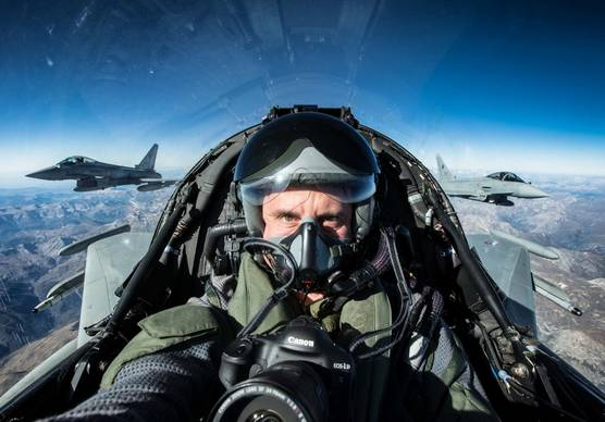 Photographer and Canon Ambassador Massimo Sestini in a fighter jet with his Canon camera.