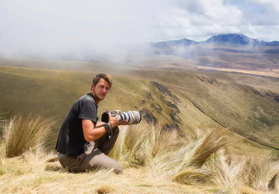 Photographer and Canon Ambassador Maxime Aliaga with his Canon camera.