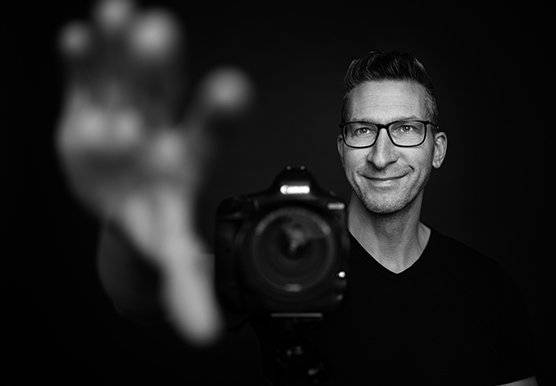 Photographer and Canon Ambassador Sascha Hüttenhain with his Canon camera.