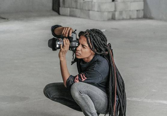 Photographer and Canon Ambassador Yagazie Emezi with her Canon camera.