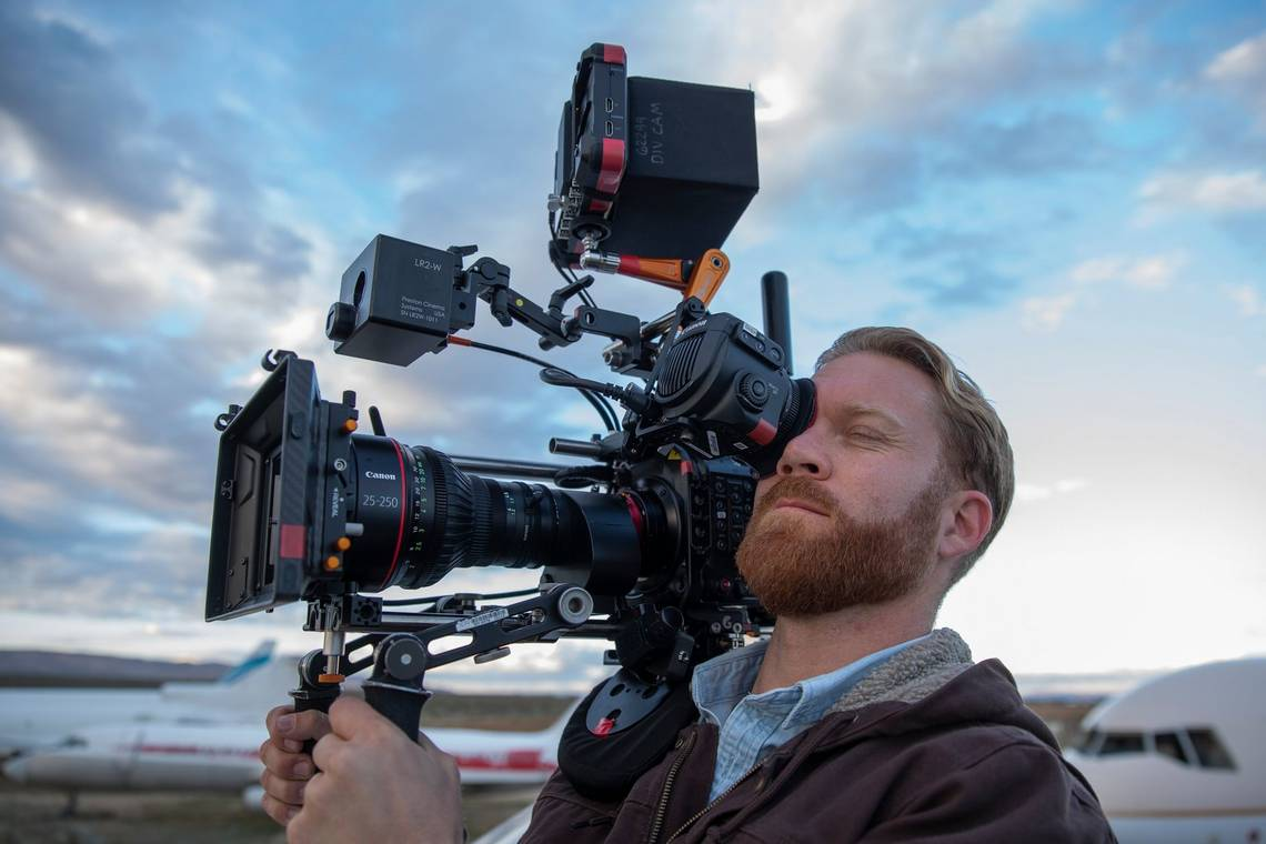 Cinematographer Steve Holleran holds a Canon EOS C300 Mark III on his shoulder.