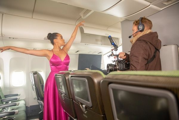 Cinematographer Steve Holleran uses a Canon EOS C300 Mark III to film a ballerina in a fuchsia silk dress, performing in the aisle of a 747.