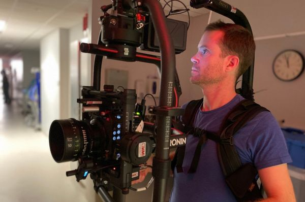 DoP Patrick Smith with the Canon EOS C500 Mark II on a handheld rig in a hospital corridor.