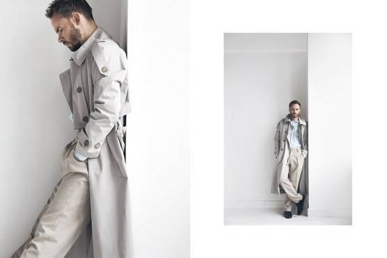 A male model wears a white coat and stands against a white wall in two shots by fashion photographer Jaroslav Monchak.