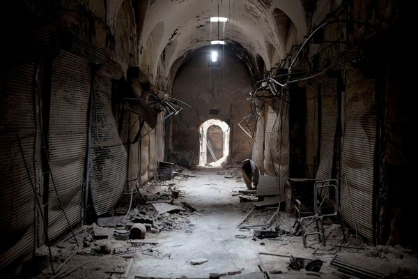 A once-busy souk near Aleppo's Umayyad Mosque lies in ruins.