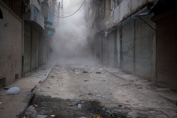An avalanche of dust engulfs shop fronts in al-Arkub, Aleppo.