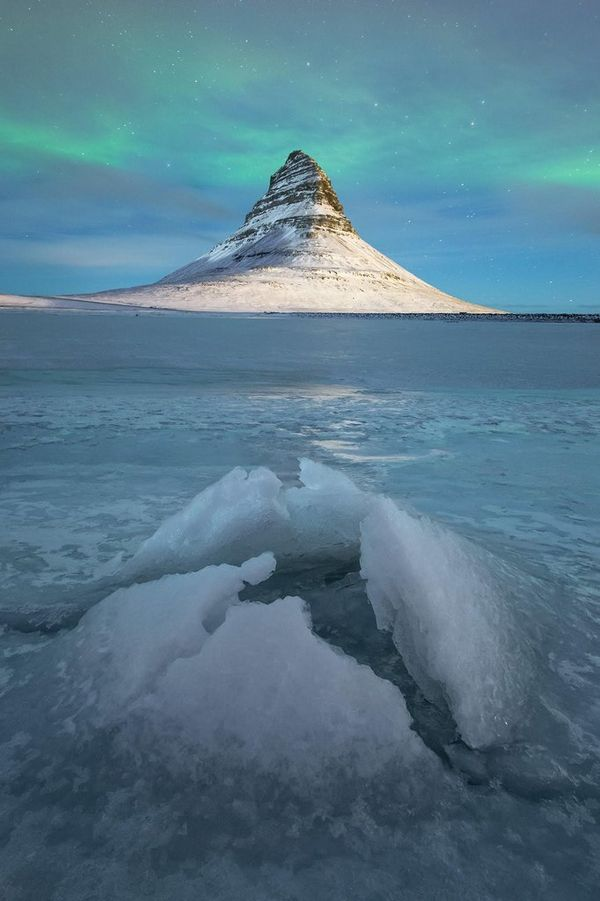 The aurora borealis over the ice at Kirkjufell, Iceland.