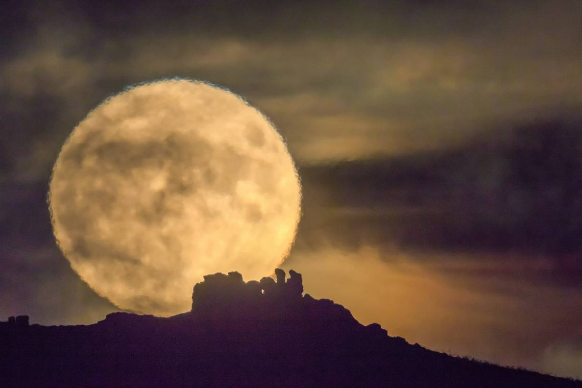 A supermoon visible over Three Fingers Rock in Shropshire.