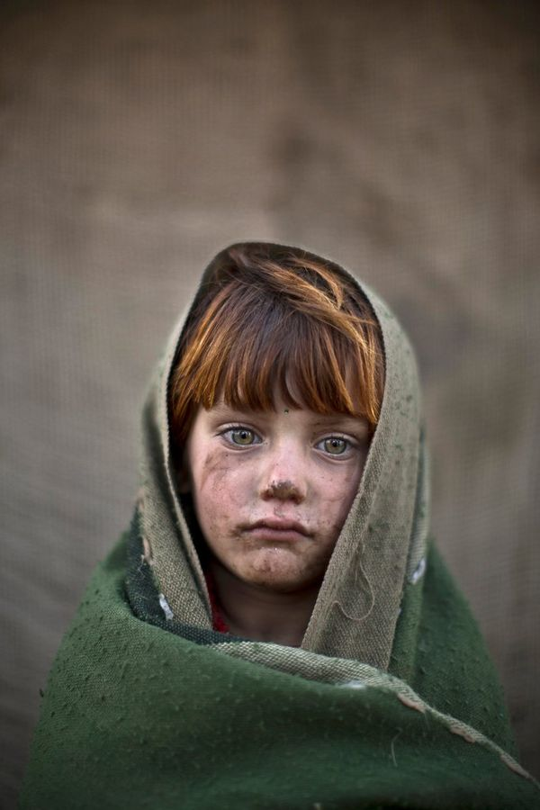 A portrait of Laiba Hazrat, a six-year-old Afghan refugee.