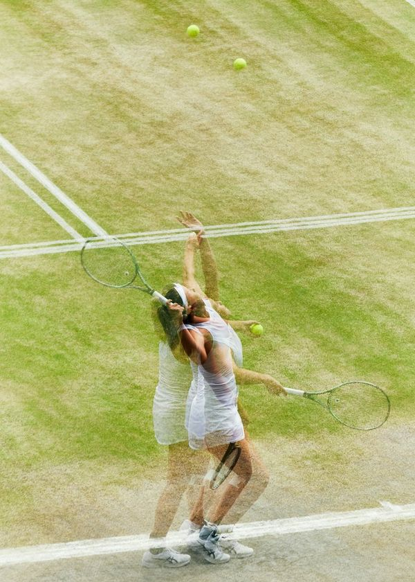 A multiple exposure photograph of a female player serving at the 2019 Wimbledon Championships Girls' Singles final.