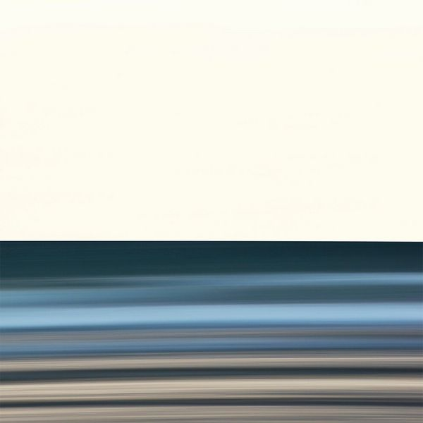 An abstract shot of a beach scene, the colours blurred.