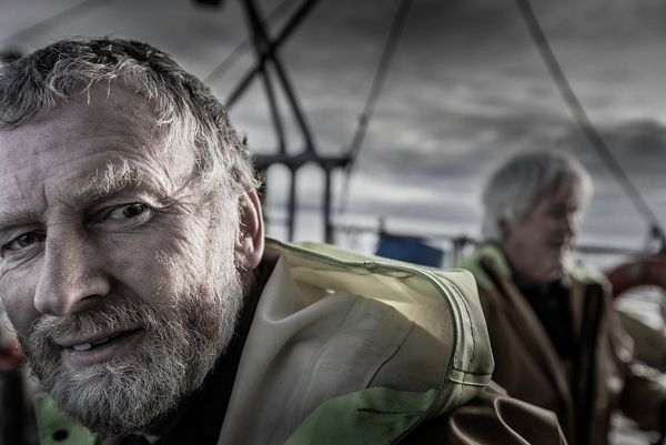 A portrait of fisherman John Baker on his boat.