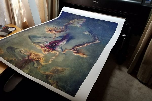 A large fine art style print emerges from a Canon imagePROGRAF PRO-4100 printer.