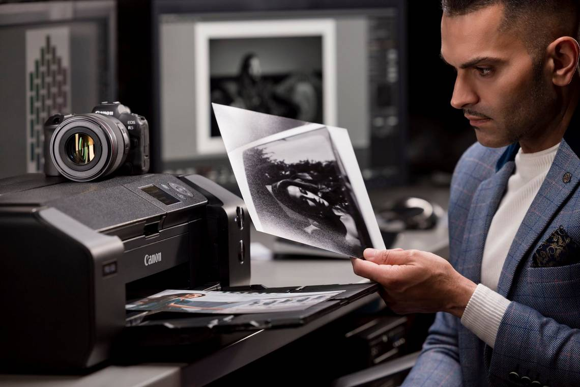Wedding photographer Sanjay Jogia holds a black and white image printed on a Canon imagePROGRAF PRO-300.