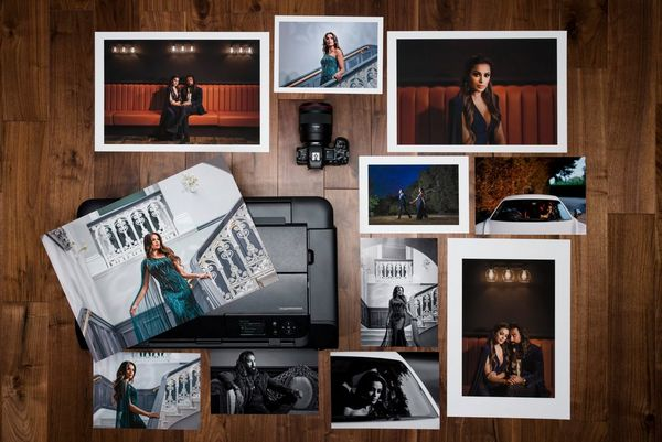 A selection of prints arranged around a Canon imagePROGRAF PRO-300 printer.