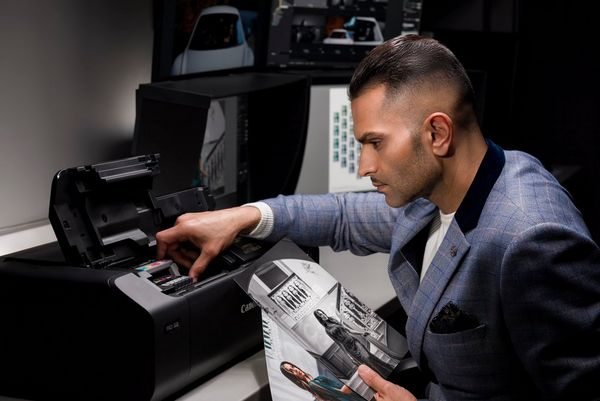 Wedding photographer Sanjay Jogia changes the ink cartridge in a Canon imagePROGRAF PRO-300 printer.