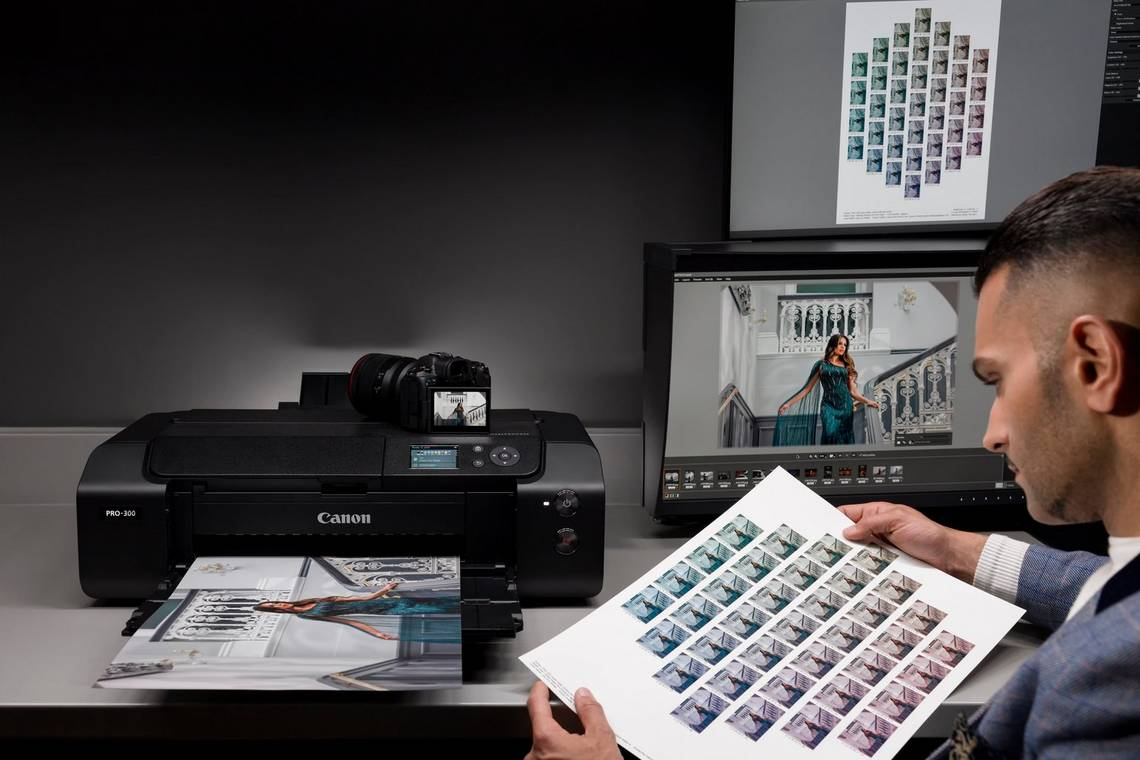 Photographer Sanjay Jogia studies a sheet of image thumbnails printed by a Canon imagePROGRAF PRO-300.