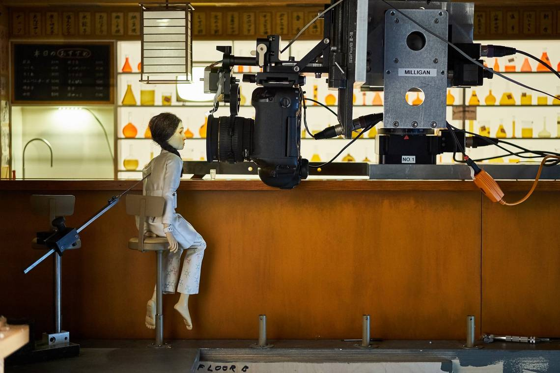 A Canon EOS-1D X camera mounted on a motion control rig and positioned next to a puppet on the set of Wes Anderson's Isle of Dogs.